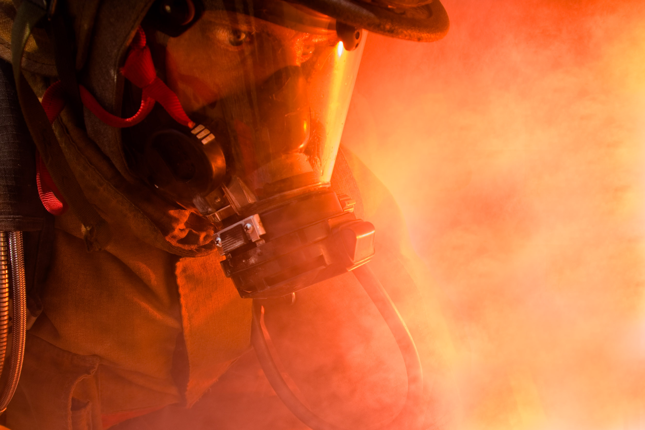 Close portrait of a firefighter in action.