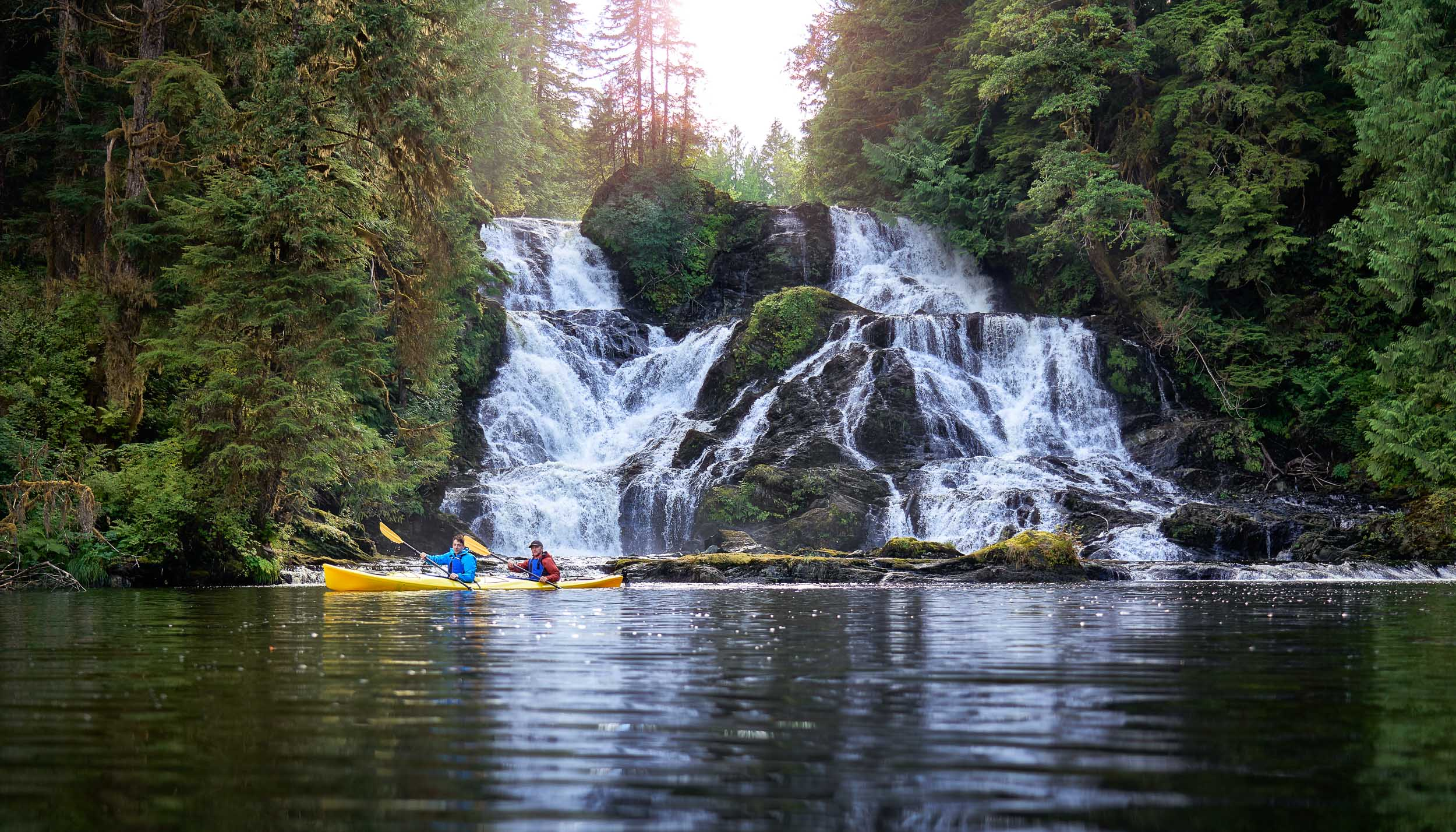 Kayaking in front of a beautiful waterfall