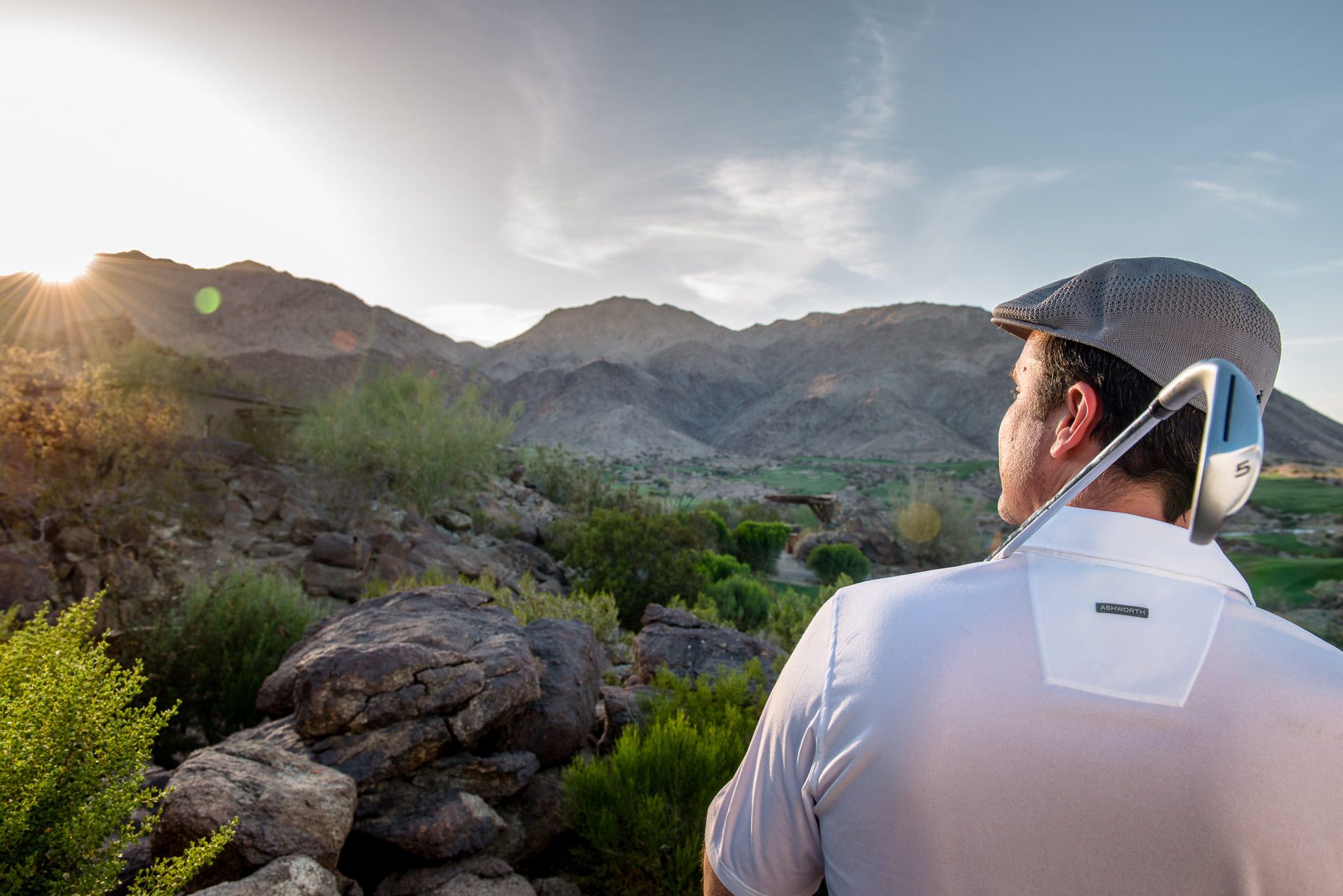 A golfer watching the sun set over the Palm Springs golf course