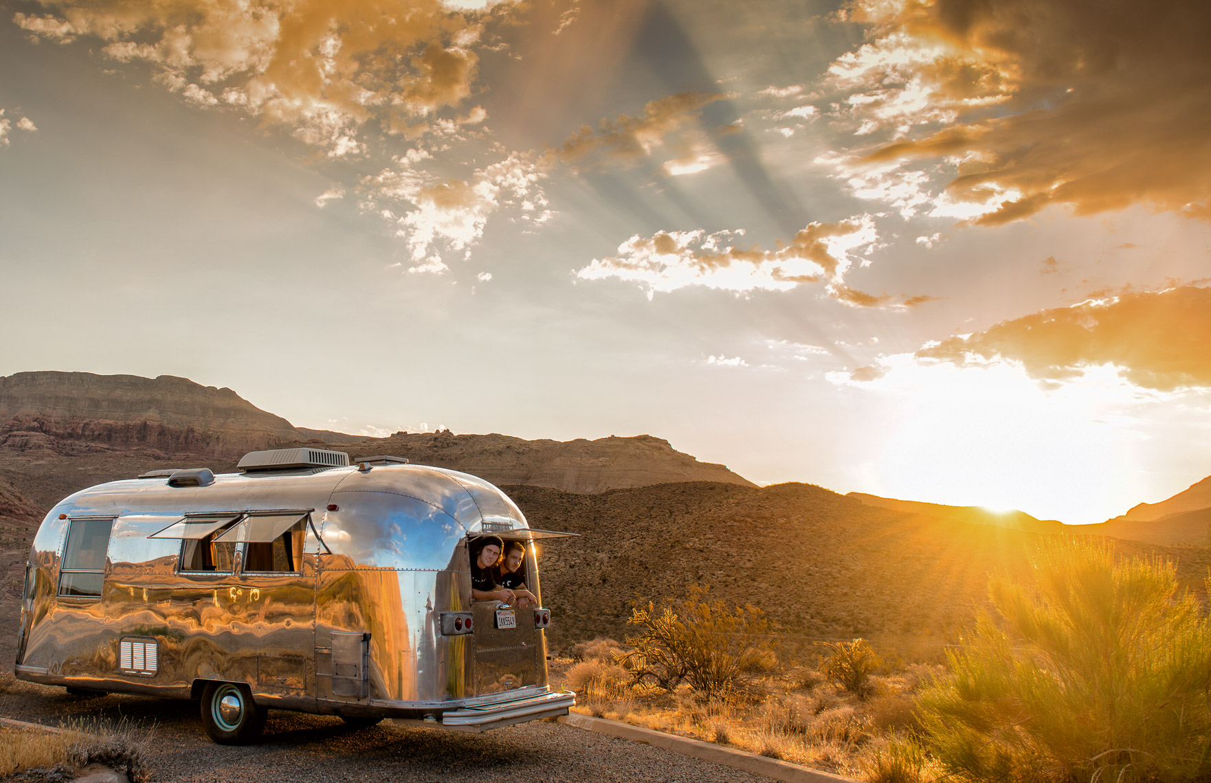 Kevin Steele - Young men look out of a vintage Airstream