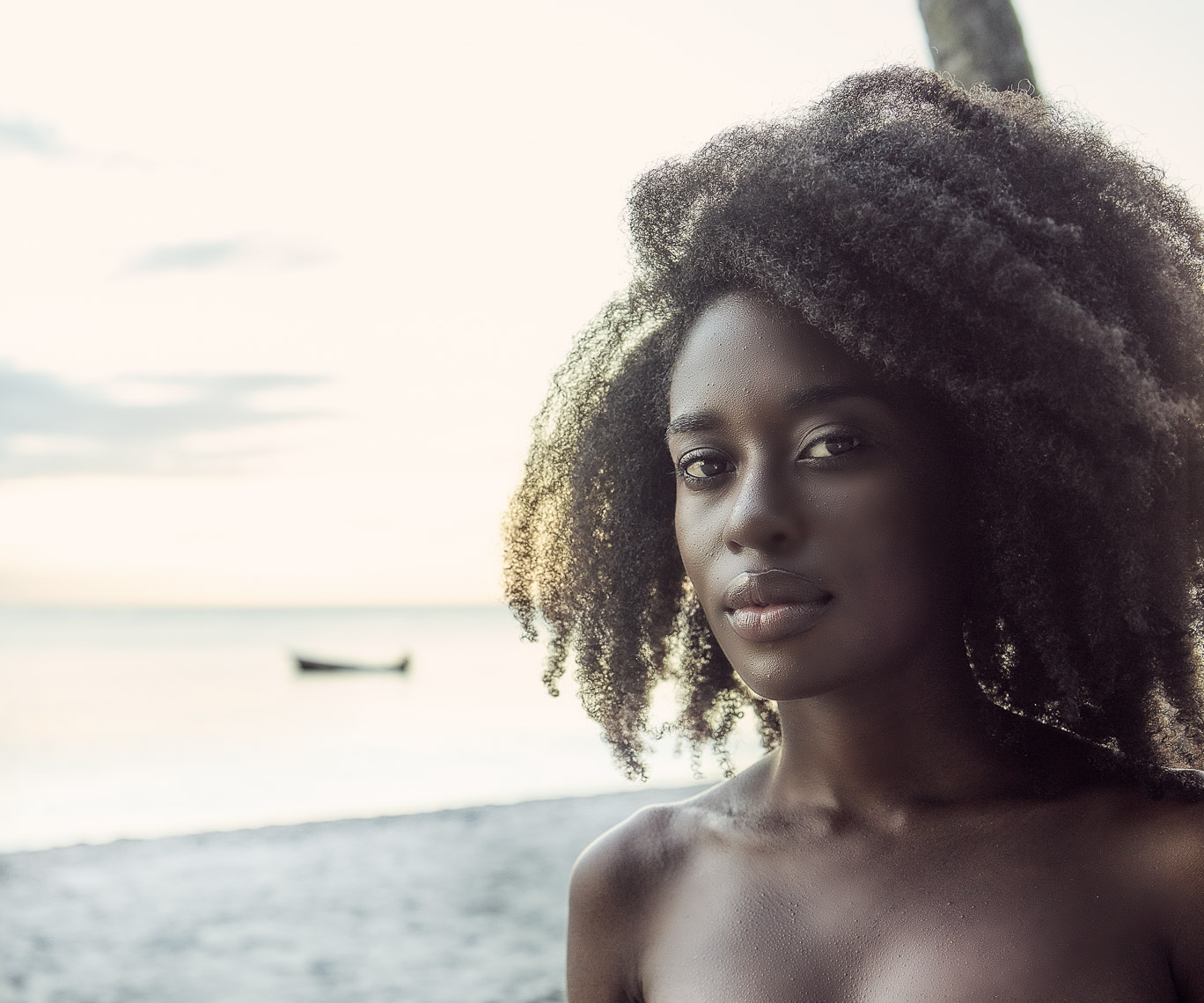 Kevin Steele - portrait on the beach of a beautiful black woman