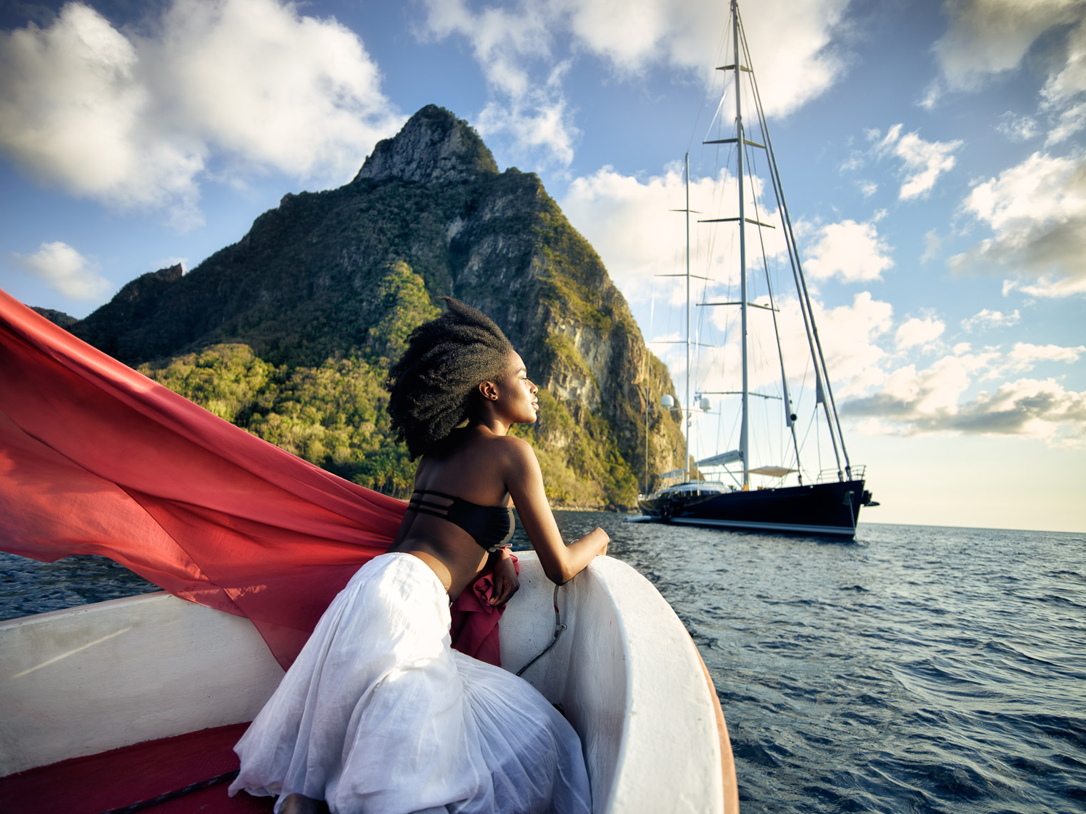 A young woman approaches a luxury yacht on St Lucia