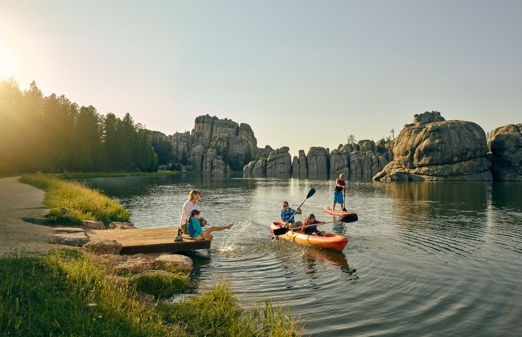 Family lifestyle with canoe and paddle board on a Black Hills lake