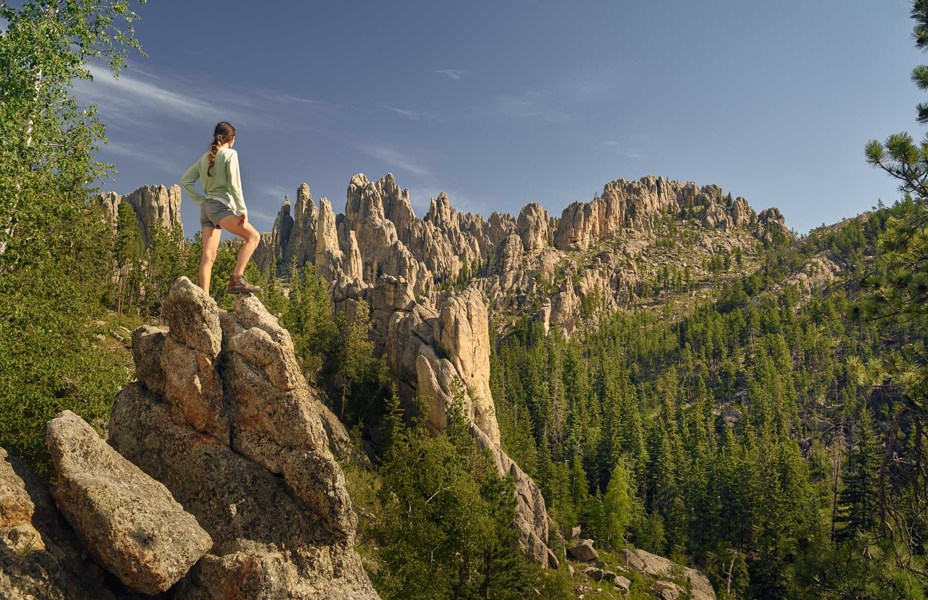 Kevin Steele - A woman hiking the South Dakota Black Hills