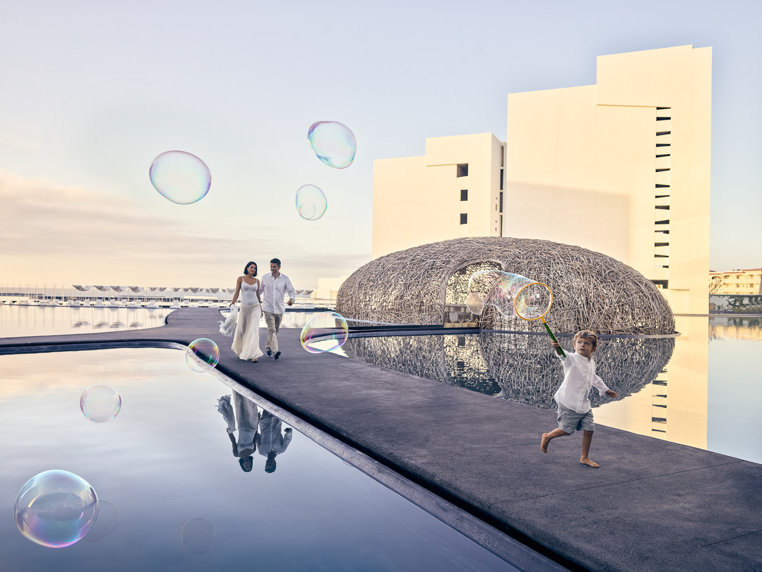 Kevin Steele - a boy runs with bubbles at a unique luxury hotel