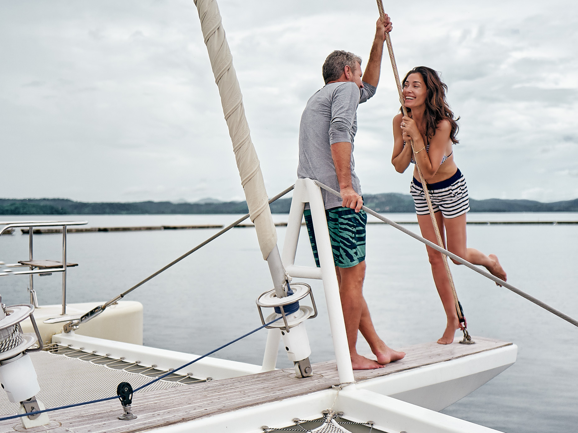 A couple on a catamaran having fun