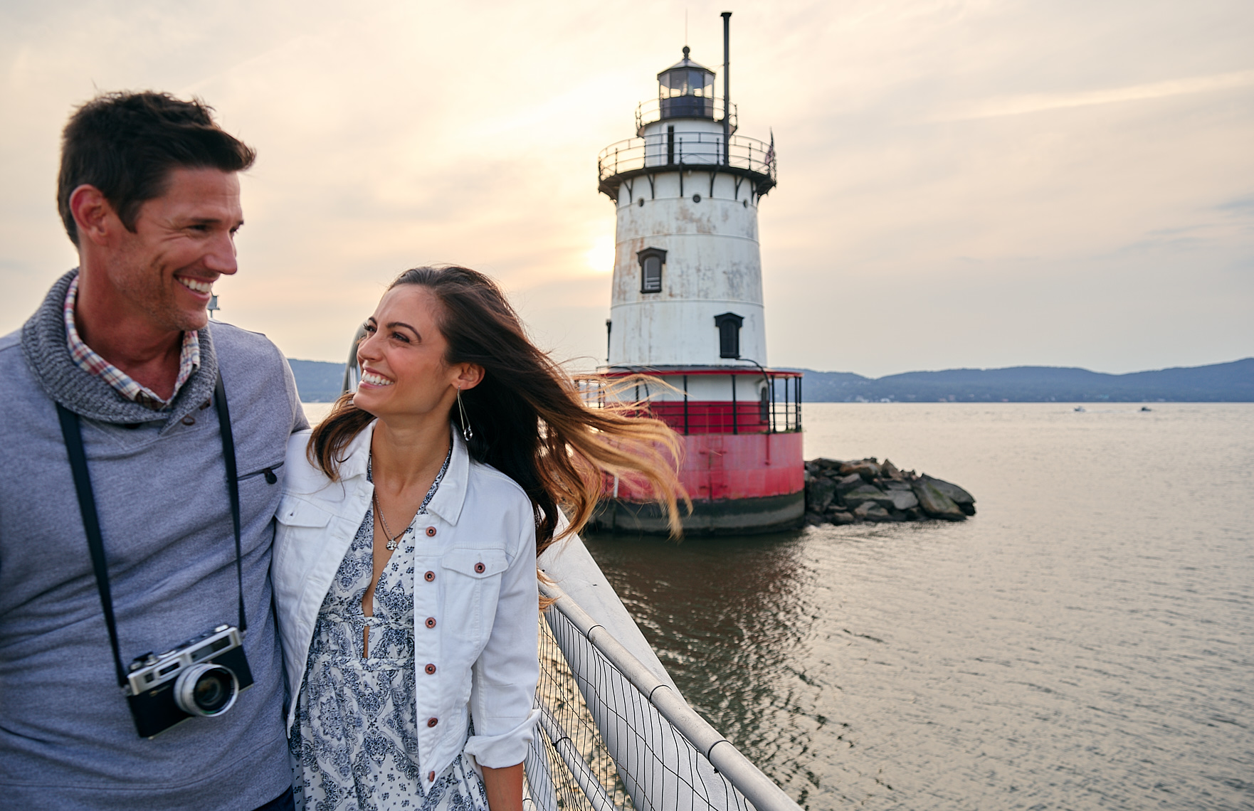 Travel lifestyle,  a young couple laughs along the Hudson