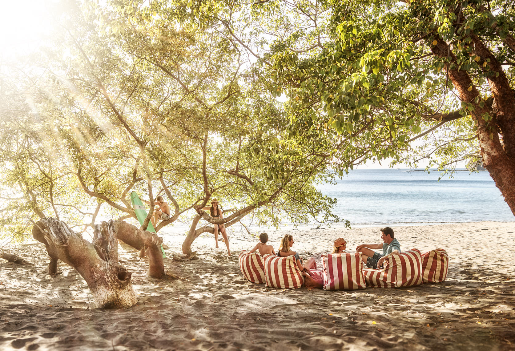 Kevin Steele - a family relaxes on the Costa Rican tree lined beach