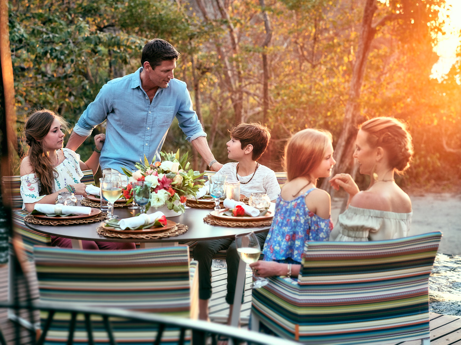 Kevin Steele - a family lifestyle dinner outdoors as the sun sets