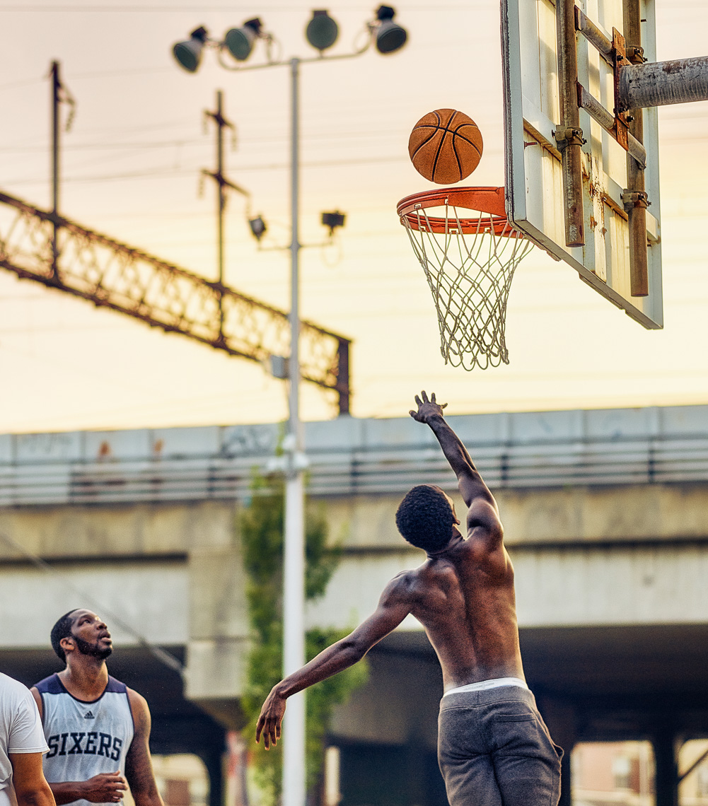 Kevin Steele - basketball players in an urban park