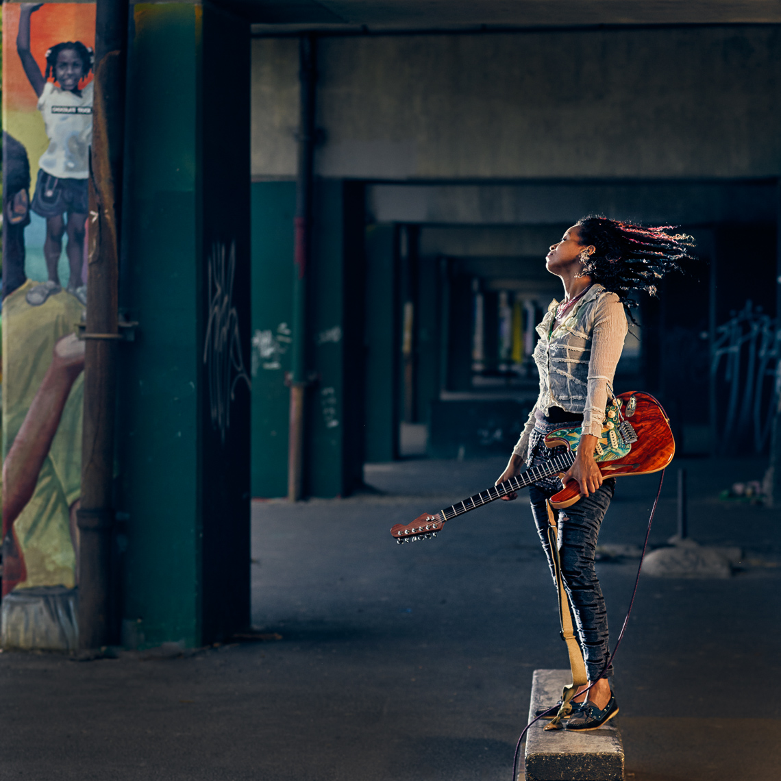 Kevin Steele - portrait of a musician and her guitar in the city