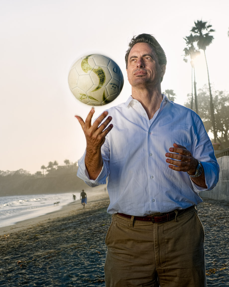 Kevin Steele  - portrait of a man and soccer ball on the beach