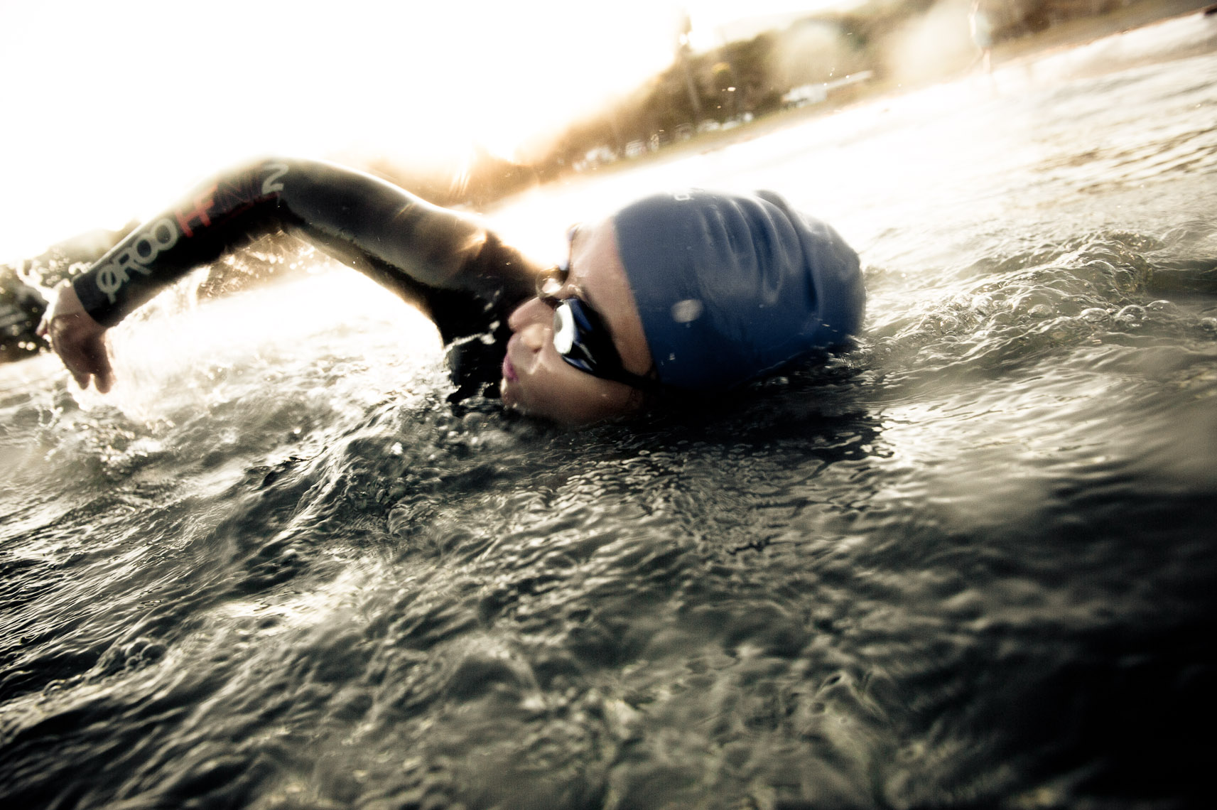 Kevin Steele - woman triathlete swimming in the ocean