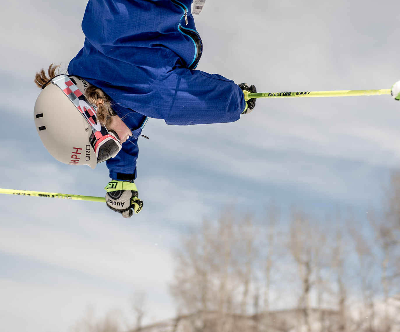 Kevin Steele - a skier performs an acrobatic  jump