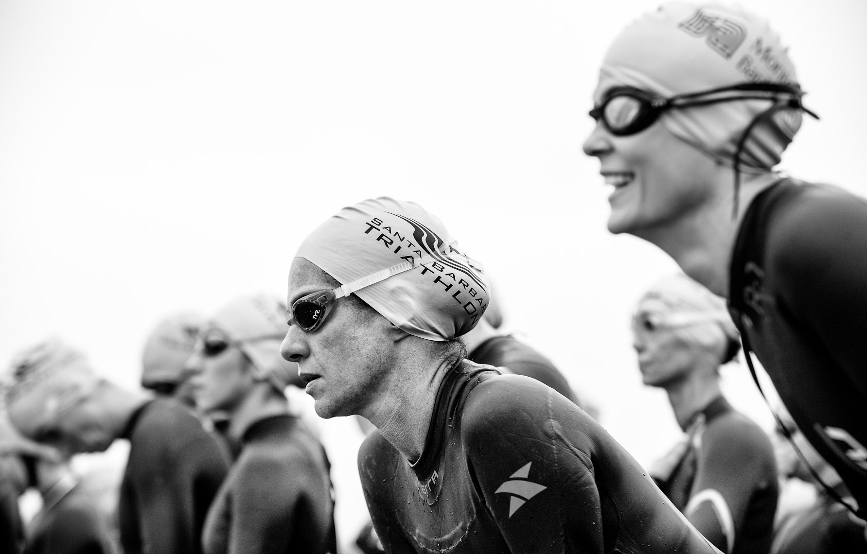 Kevin Steele - close up of triathletes faces at the starting line