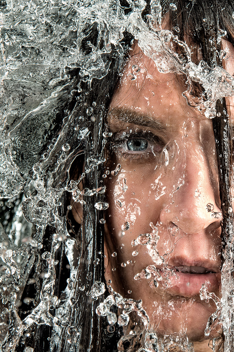 Kevin Steele - close up of water falling down woman