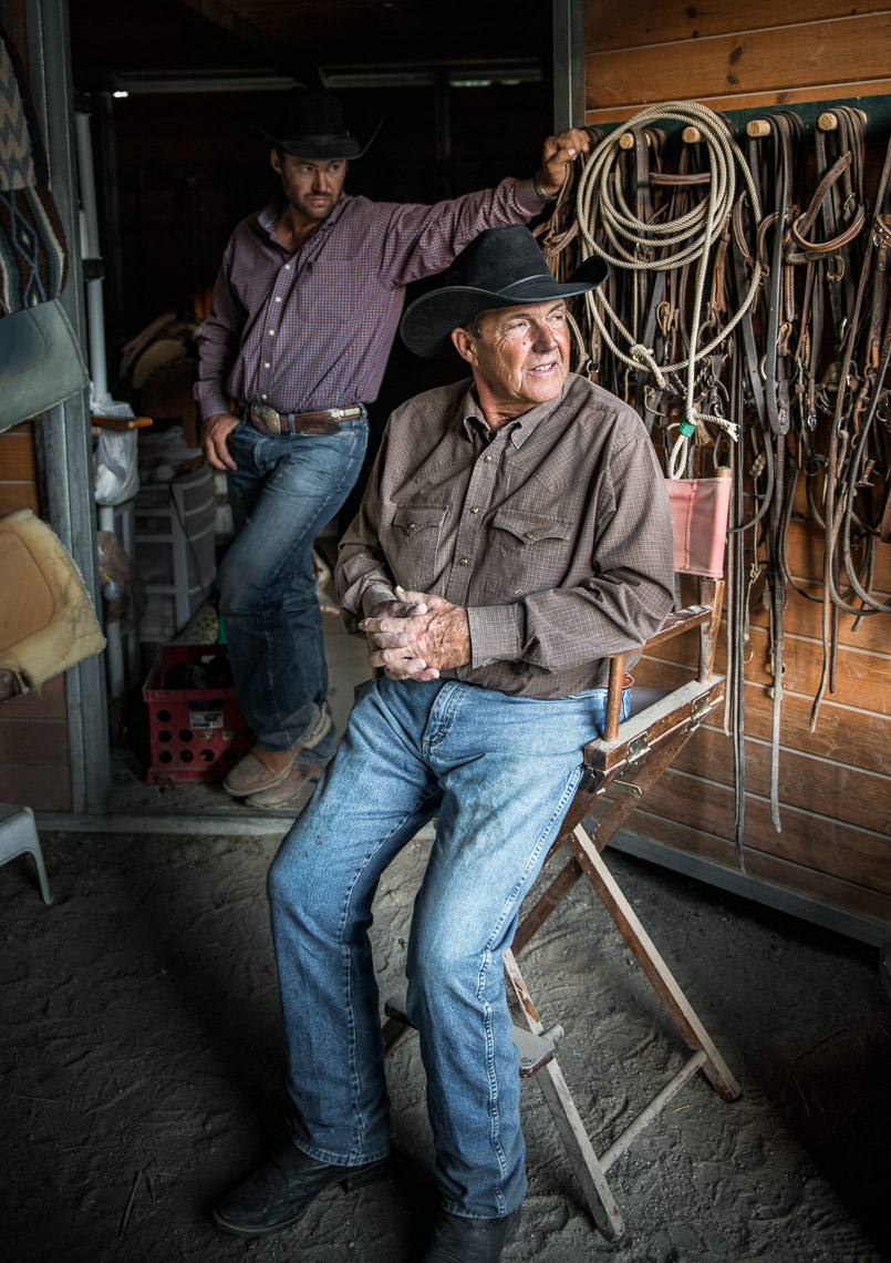 Kevin Steele - portrait of two cowboys in the barn