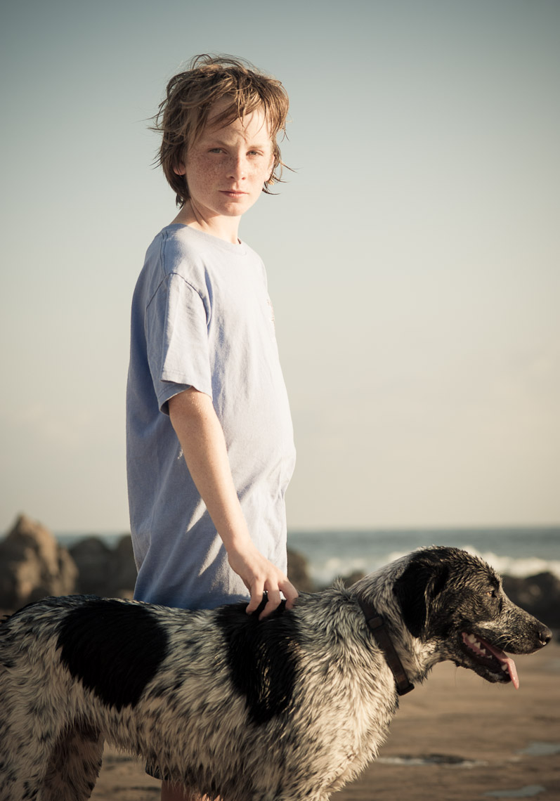 Kevin Steele - portrait of a boy and dog on the beach