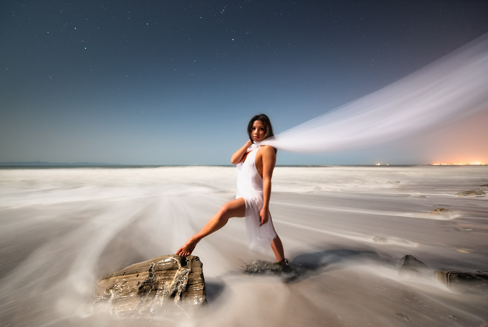 Kevin Steele - moonlit beach time exposure and a young woman