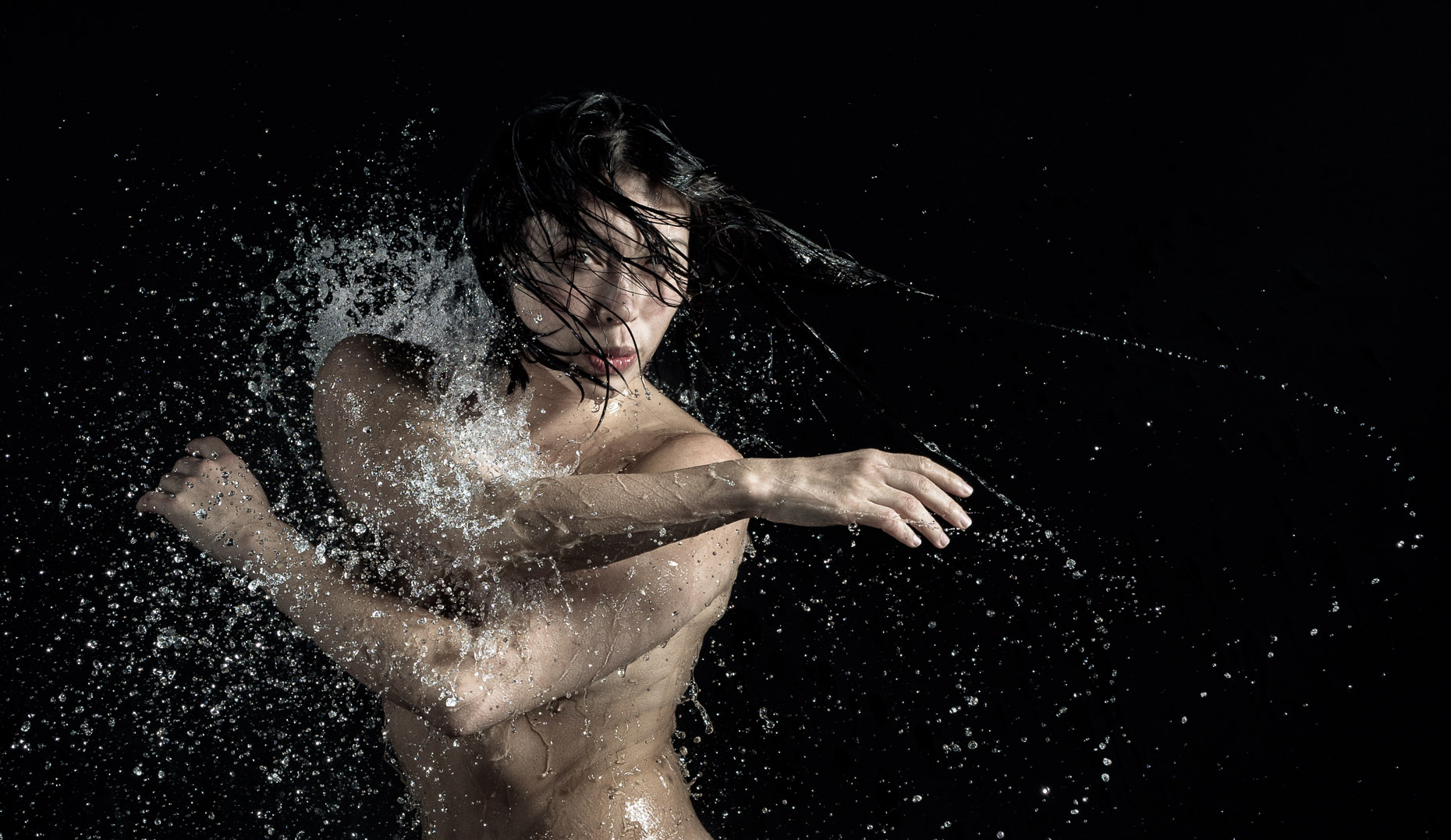 Kevin Steele -  studio portrait under falling water